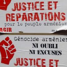 Affiche revendicatrice apposée sur un mur de Paris, 2015