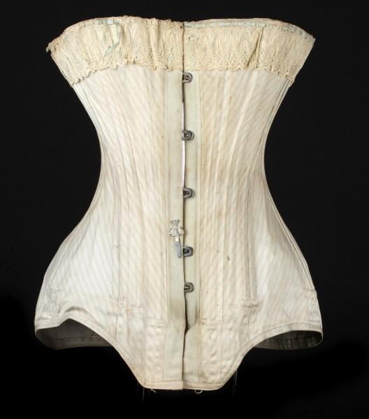 Corset baleiné en coutil de coton imprimé de rayures, fermé par des agrafes métalliques et resserré par un lacet, provenant de chez Lysens Soeurs, corseterie située rue Vinâve d'Ile à Liège, vers 1900.